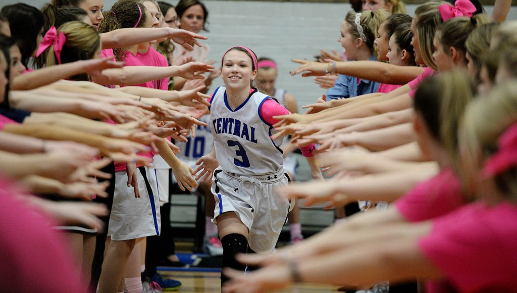 Central Indians sophomore Jaelyn Haggard runs through a sea of hands during opening introductions against Ruskin at Central High School.