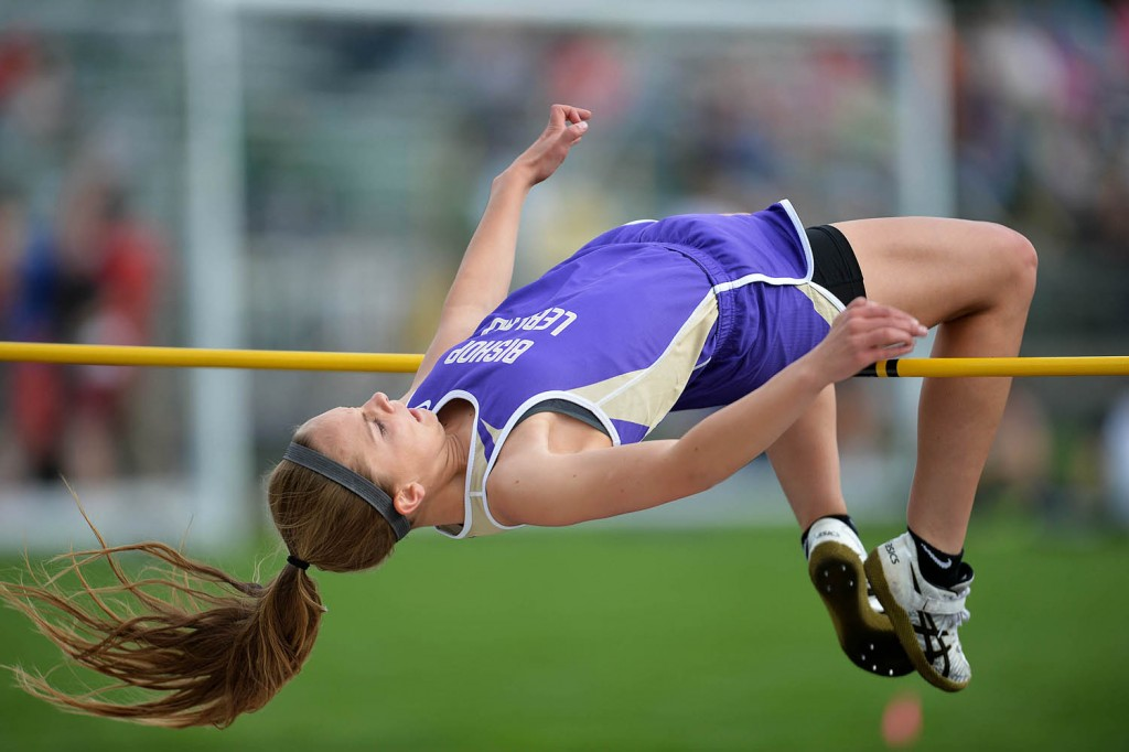 """Jaclyn Dickens of Bishop LeBlond does a classic """"Fosbury Flop"""" to clear 5'2"""" and win the girls high jump at Lafayette High School."""
