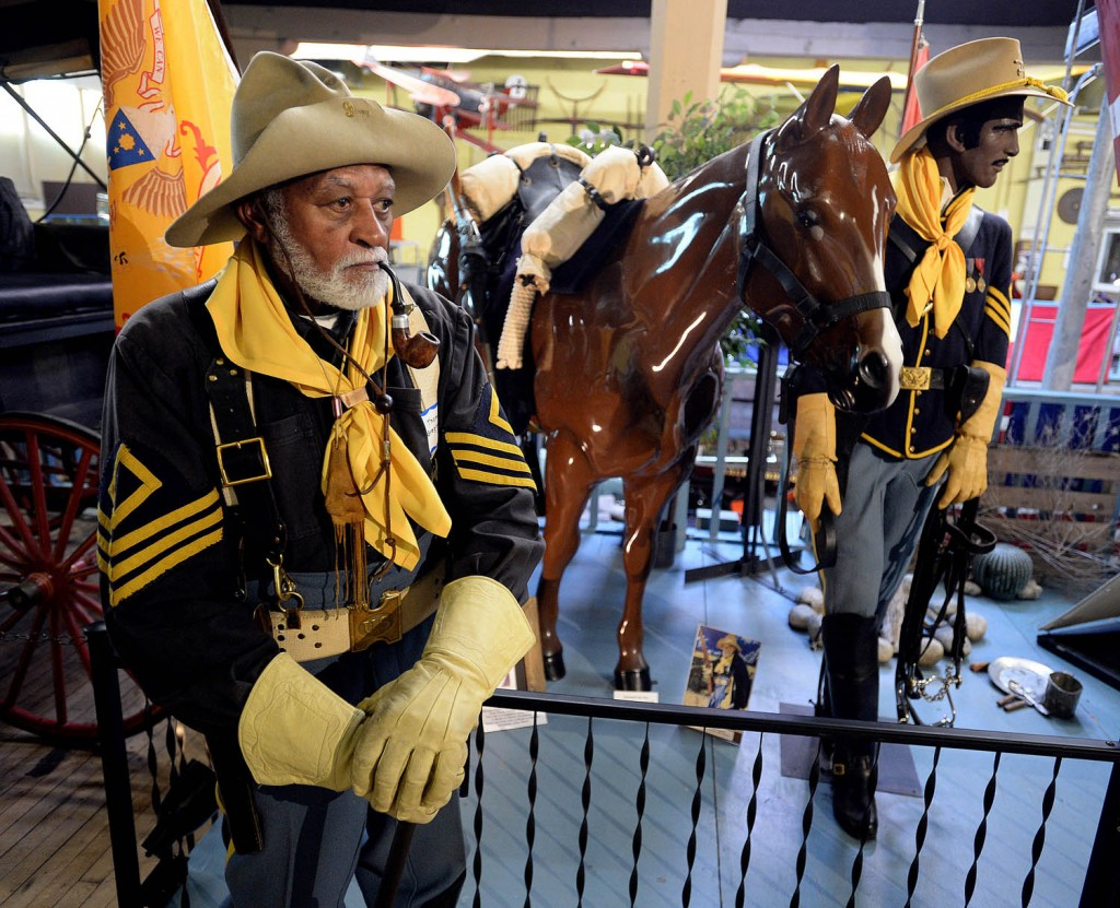1st Sgt. Thomas Gregory, 80, of Harrisonville, Mo. stands in full Civil War attire next to a replica depicting his late Great Uncle Net Gregory who was a soldier in the 9th Calvary. Members of the Kansas City-Leavenworth Chapter of the Buffalo Soldiers were on hand to answer questions during a grand opening of the Buffalo Soldiers exhibit at the Patee House Museum.
