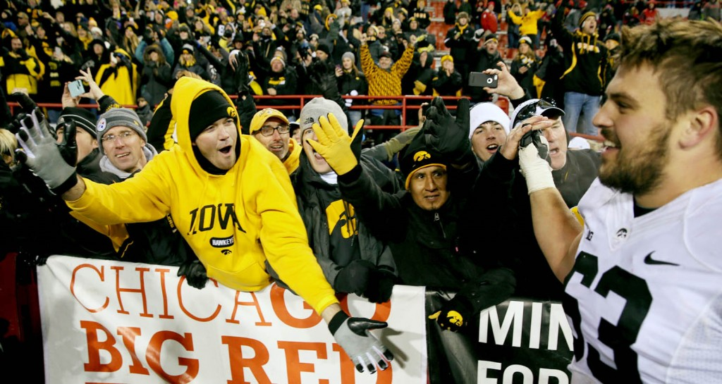 Iowa fans celebrate with offensive lineman Austin Blythe concluding a 28-20  victory over Nebraska  Saturday at Memorial Stadium.