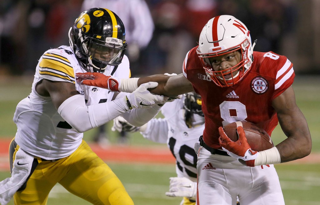 Nebraska punt returner Stanley Morgan Jr.tries to break free from Iowa's Desmond King during 2nd half action Saturday.