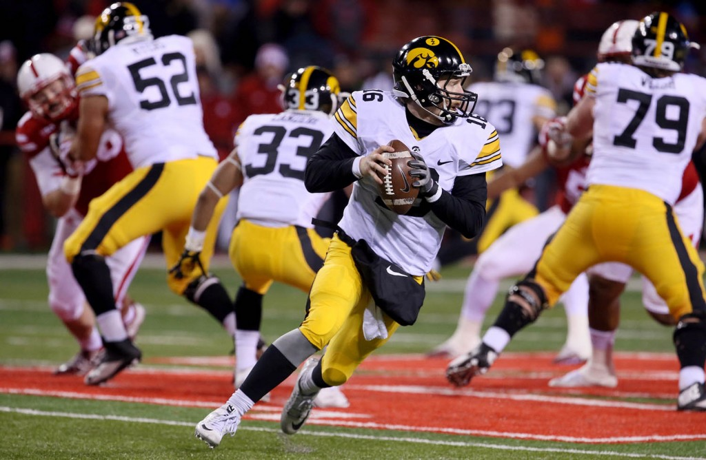 Iowa quarterback C.J. Beathard rolls outside of the pocket against Nebraska duirng second half action Saturday.