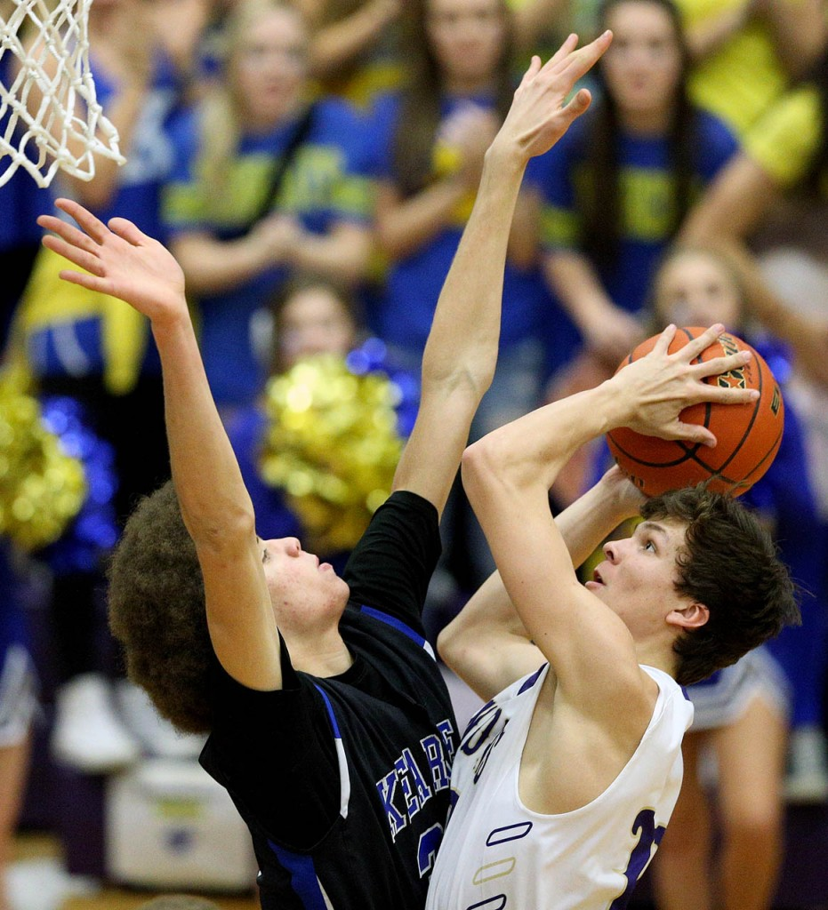 Grand Island junior Brayden Wald scores around Kearney''s freshman Shiloh Robinson during first quarter action Friday night. (Independent/Andrew Carpenean)