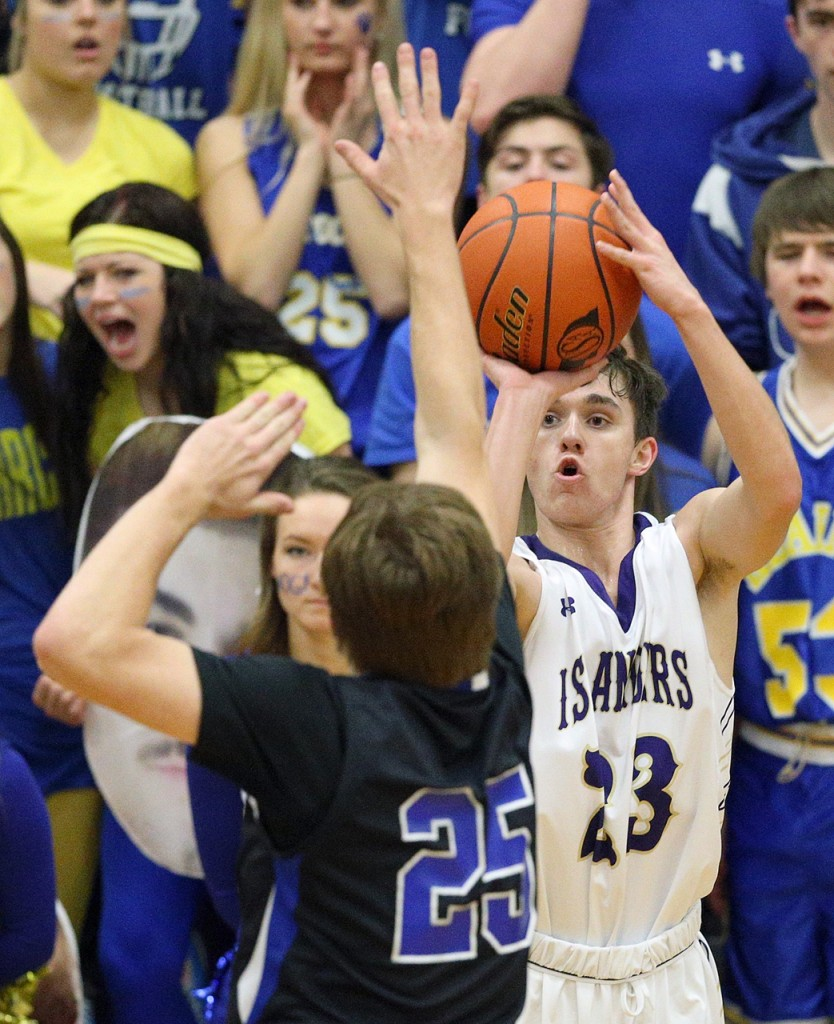 Grand Island sophomore Will Nordhues hits a three-pointer over Kearney's Ryan Koski during first quarter action Friday night. (Independent/Andrew Carpenean)