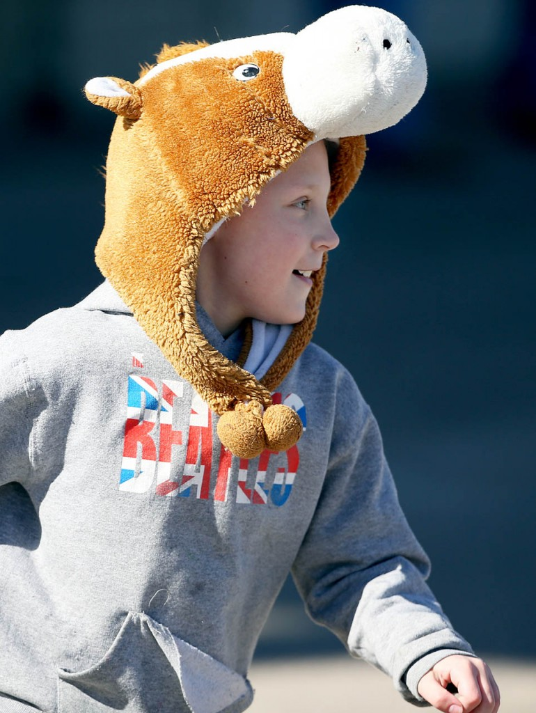 Leyton Kage wears a horse hat during opening day at Fonner Park.