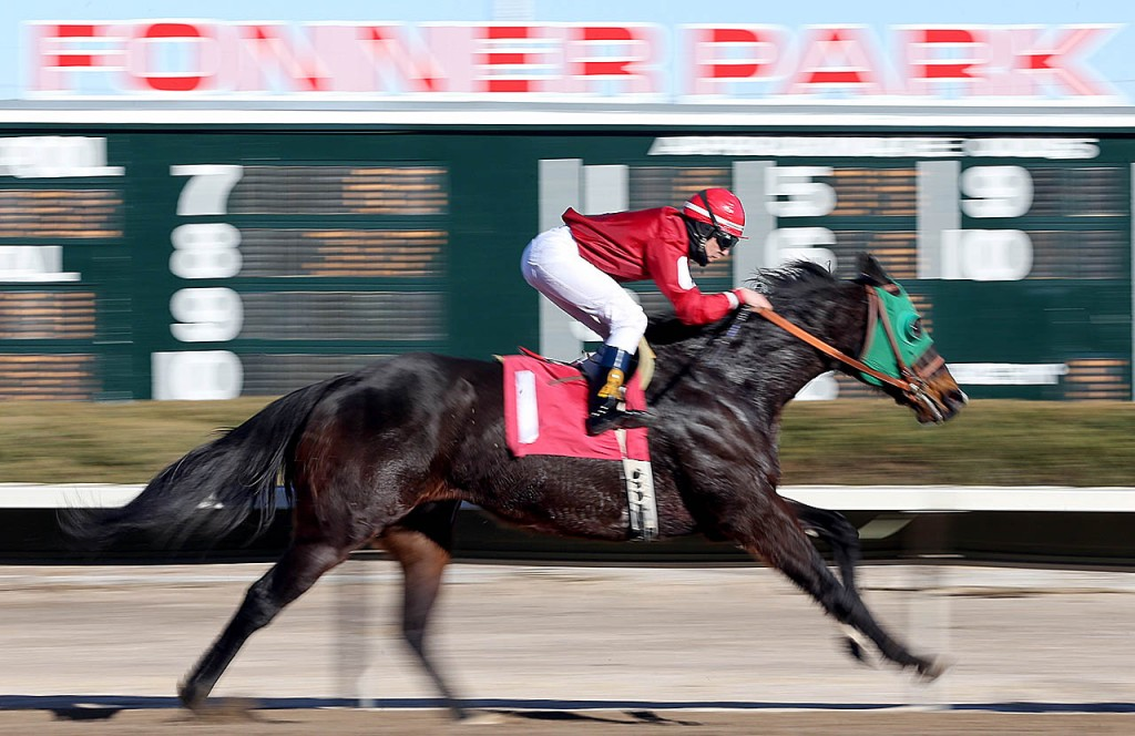 A horse named Drama Coach wins the 5th race during opening day at Fonner Park.