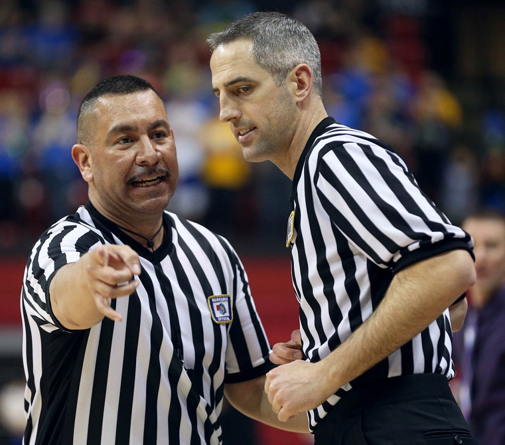 Two referees confer over a call during the Riverside vs. Humphrey St. Francis during the NSAA State Boys Basketball Championships at the Bob Devaney Sports Complex Friday. Humphrey St. Francis won 40-39.