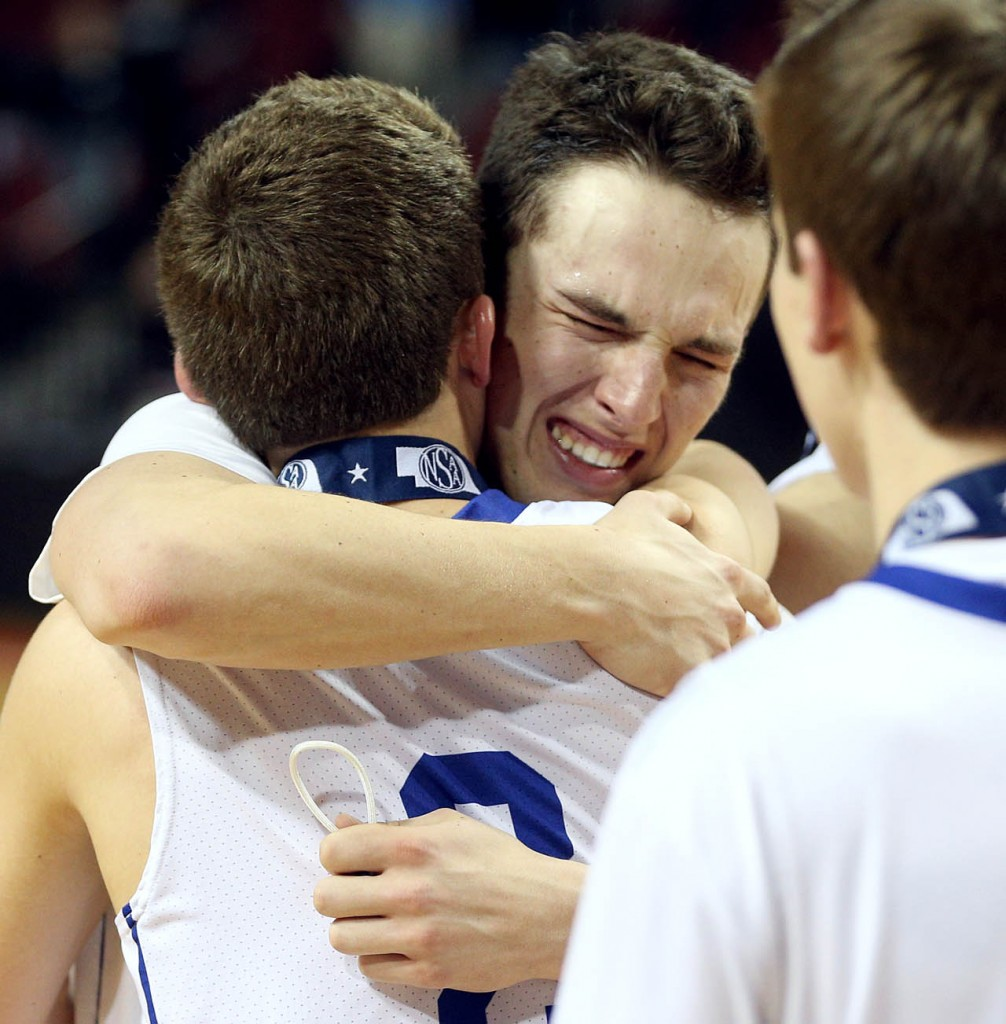 Hastings St. Cecilia senior Brooks Asher hugs his brother sophomore Trey Asher while celebrating a 57-38 victory over Elmwood-Murdock at the NSAA State Boys Basketball Championships finals at the Pinnacle Bank Arena Saturday.