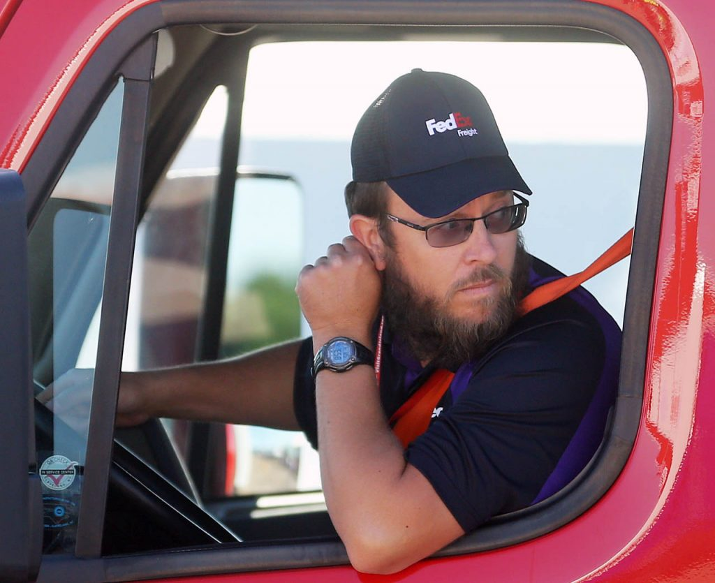 Emery Maring with FedEx Freight backs up in a docking station while competing in the Nebraska Truck Driving Championships at Fonner Park Saturday. (Independent/Andrew Carpenean)