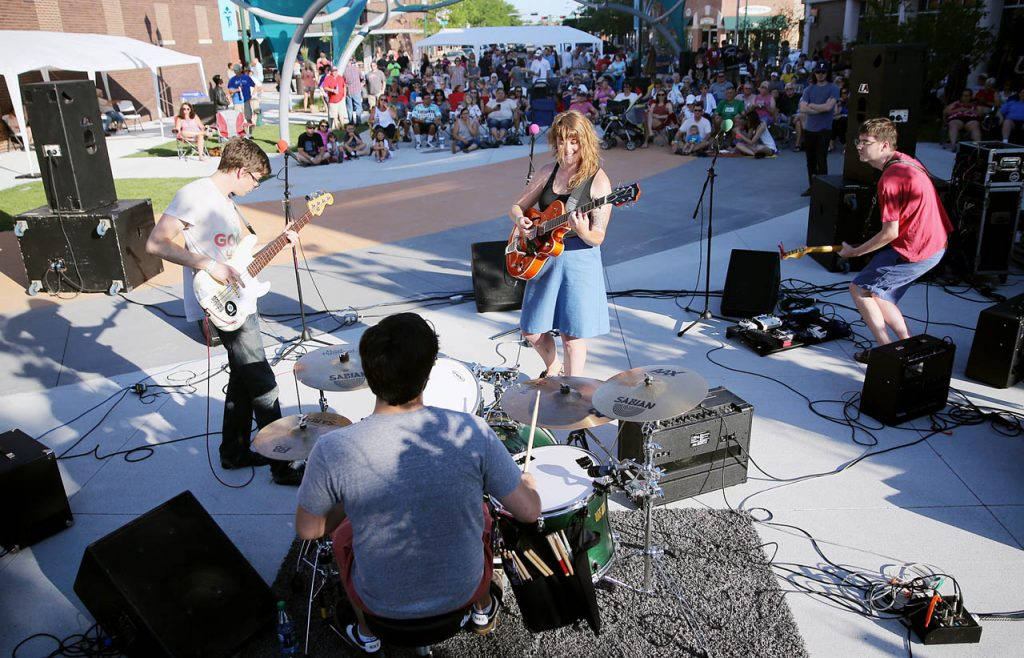 The Kait Berreckman Band performs during Hear Grand Island at the Railside Plaza on a Friday evening.