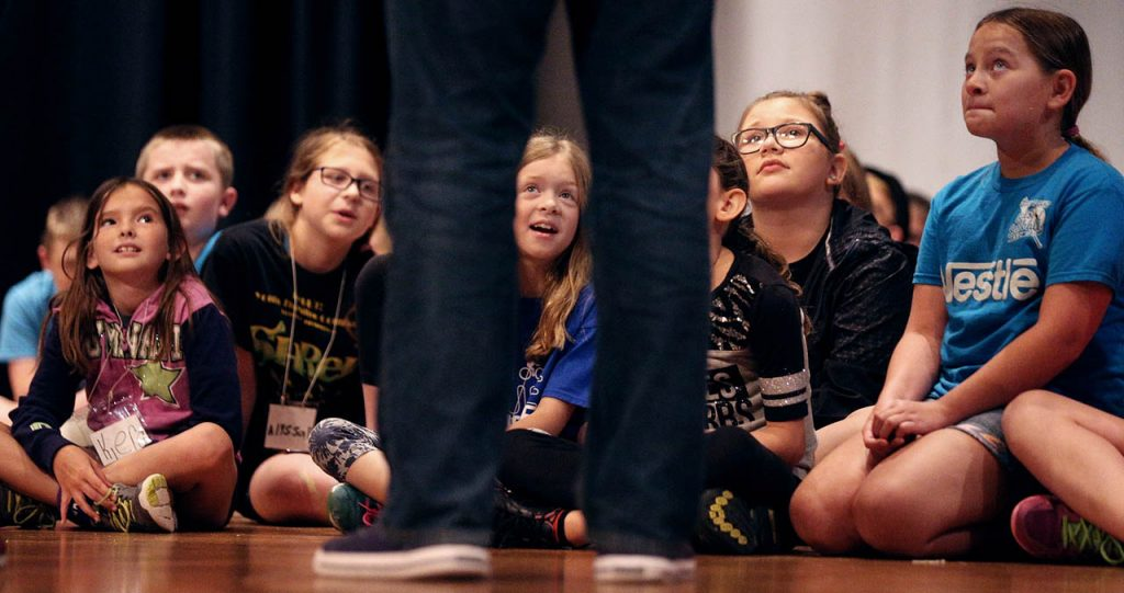 Grand Island Little Theater Jr. kids listen to Brian Mohr while preparing for Twain's Tales during a week long workshop at College Park Auditorium Thursday.