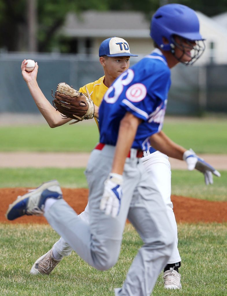 Tom Dinsdale pitcher Brooks Douglas throws to first for a ground out on First Nationals of North Platte's Caleb Horne at Ryder Park Friday. (Independent/Andrew Carpenean)