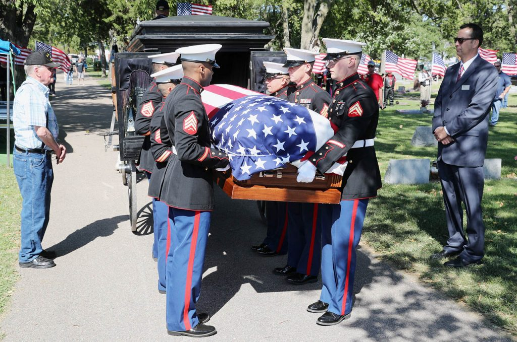 Detachment I Maintenance Company Combat Logistics Battalion 451 USMC Marines from Omaha, Neb are casket bearers for Pvt. Dale R. Geddes. The Marines transport Geddes casket from an 1872 horse-drawn hearse Monday, Aug. 22, 2016 at Grand Island City Cemetery in Grand Island, Neb. Bill Baasch, left, and Derek Apfel, right, stand on either side. (Andrew Carpenean/The Independent via AP)