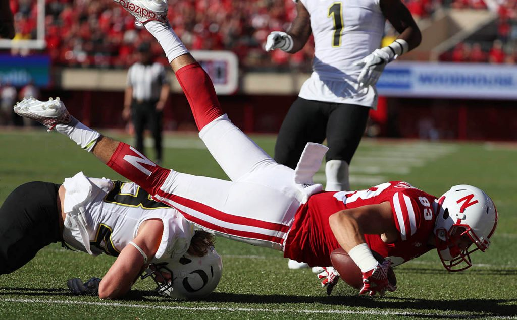 Nebraska wide receiver Bryan Reimers comes down with a touchdown reception while toppling over Oregon defensive back Brenden Schooler at Memorial Stadium.