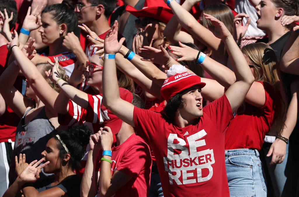 A Nebraska fan gets fired up after the Cornhuskers score against Oregon at Memorial Stadium in Lincoln, Neb.