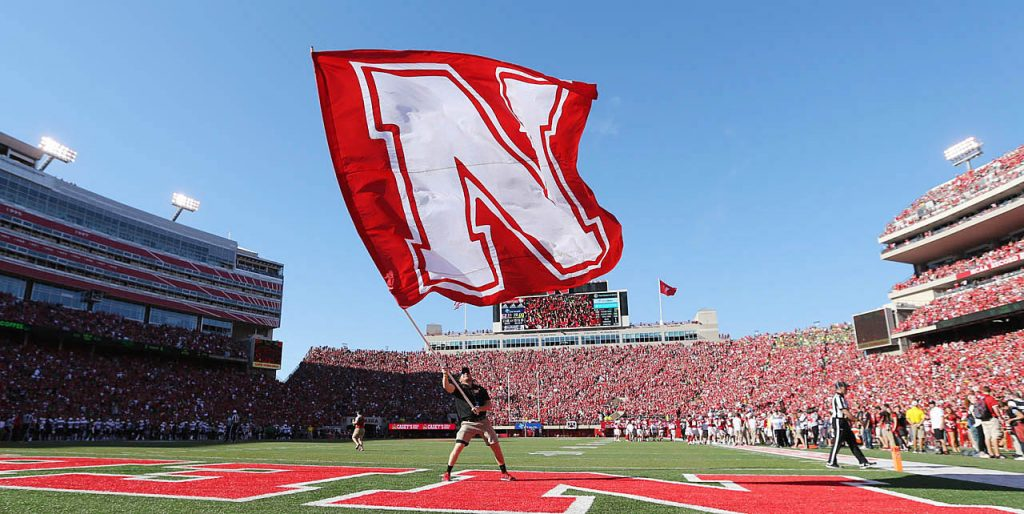 The Nebraska Cornhuskers celebrate a touchdown against Oregon with a flag waver in the end zone at Memorial Stadium in Lincoln, Neb.