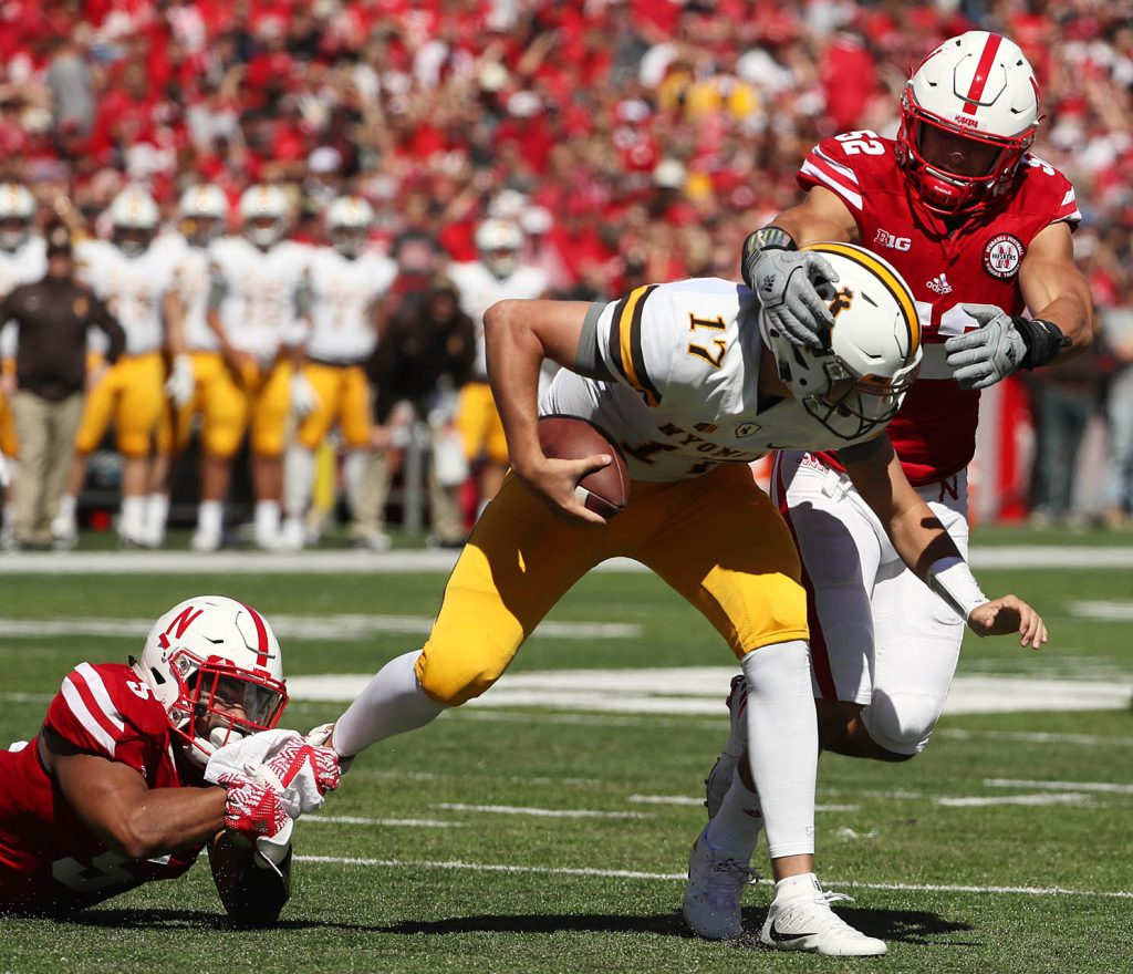 Nebraska linebackers Dedrick Young II, left, and Josh Banderas sack Wyoming quarterback Josh Allen at Memorial Stadium.