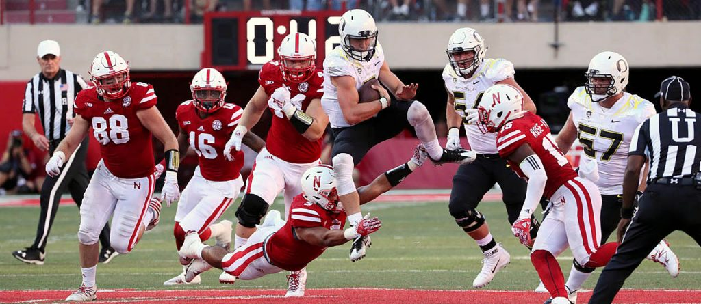 Oregon quarterback Dakota Prukop is tackled by Nebraska linebacker Dedrick Young II on fourth down at Memorial Stadium.
