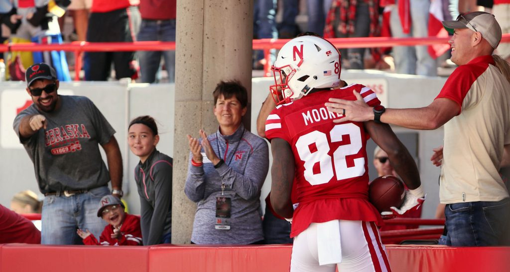 Nebraska wide receiver Alonzo Moore celebrates his touchdown catch with Huskers fans against Wyoming at Memorial Stadium.