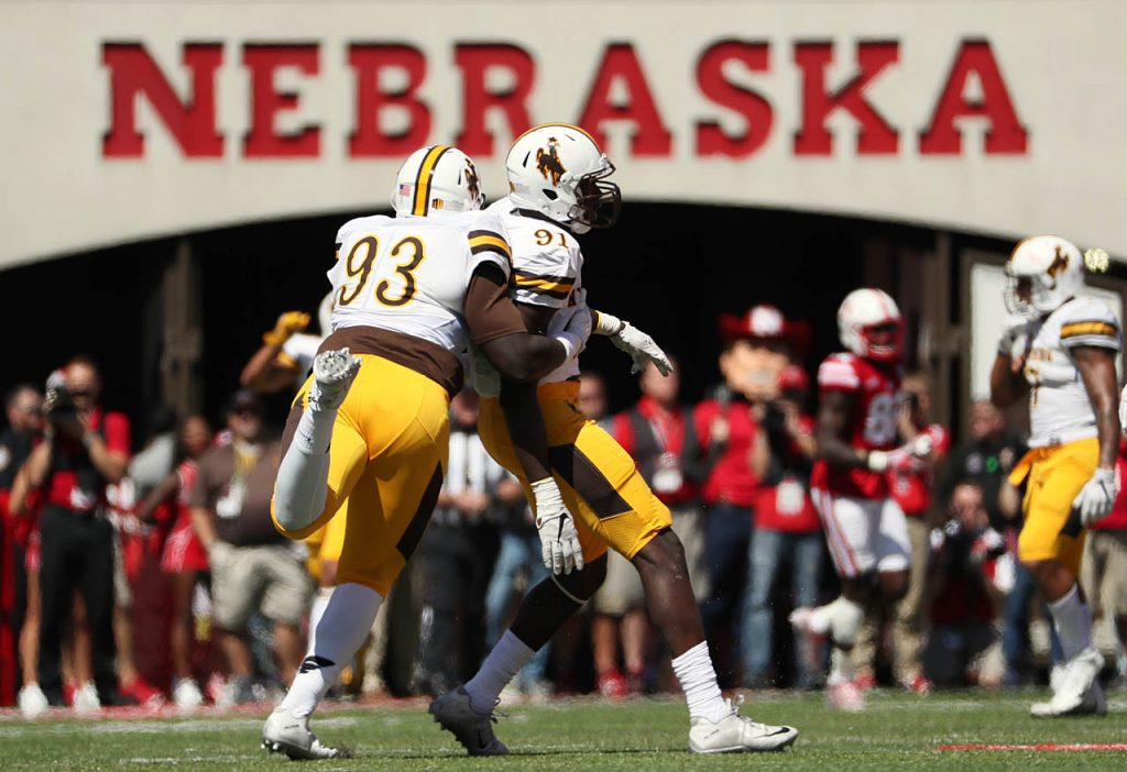 Wyoming's defensive tackle Youhanna Ghaifan (93) celebrates Carl Granderson's sack of Nebraska quarterback Tommy Armstrong Jr. at Memorial Stadium.