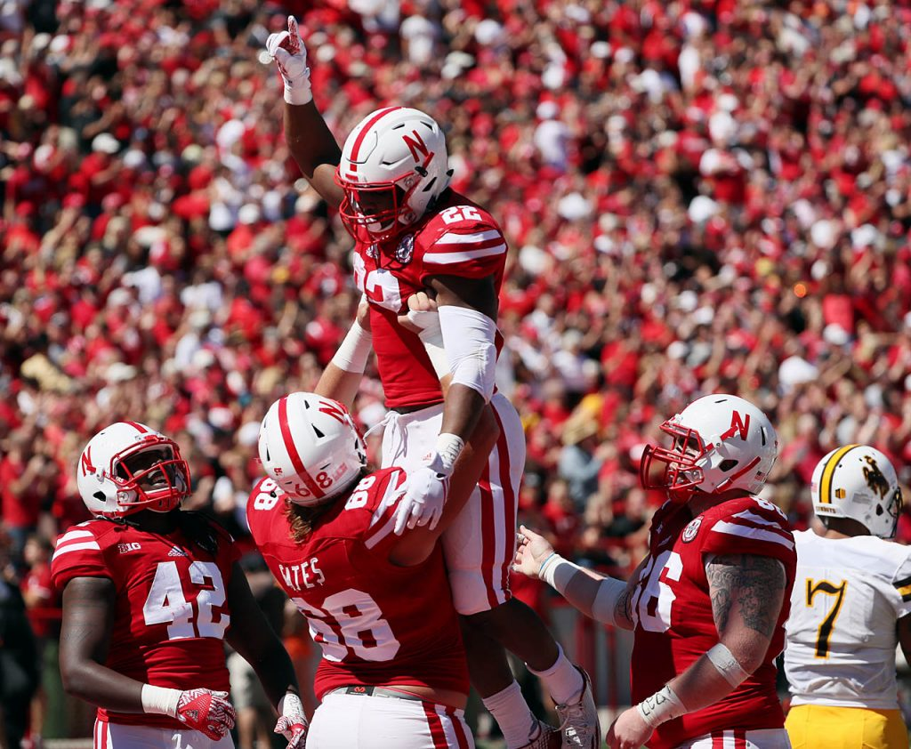Nebraska tight end Tyler Hoppes lifts Devine Ozigbo into the air while celebrating a touchdown against Wyoming at Memorial Stadium.