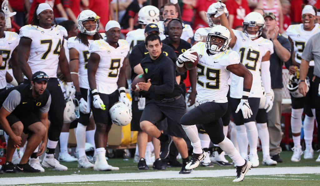 Oregon running back Kani Benoit looks back while running down the sidelines against Nebraska at Memorial Stadium.