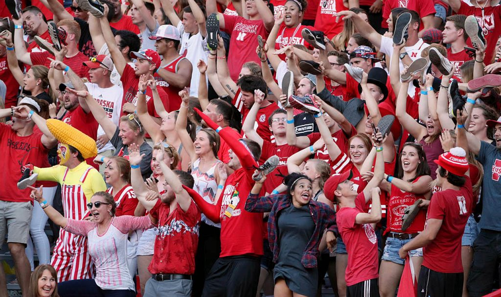 Student body fans celebrate a late fourth quarter touchdown against Oregon at Memorial Stadium.