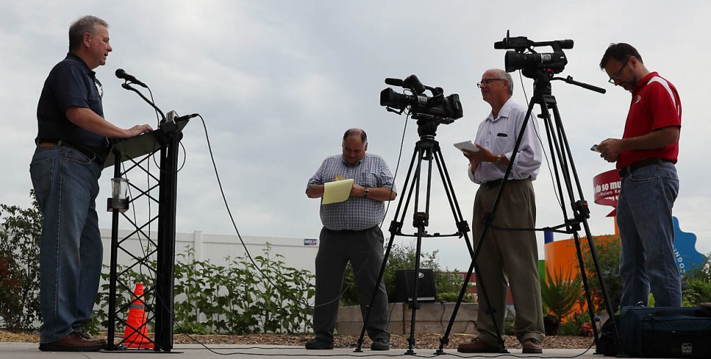 Joseph McDermott, executive director for the Nebraska State Fair gives the final attendance numbers during a press conference outside the Nebraska Building Tuesday. There were 361,107 visitors over the 11-day State Fair up by 2.5 percent from the previous year.