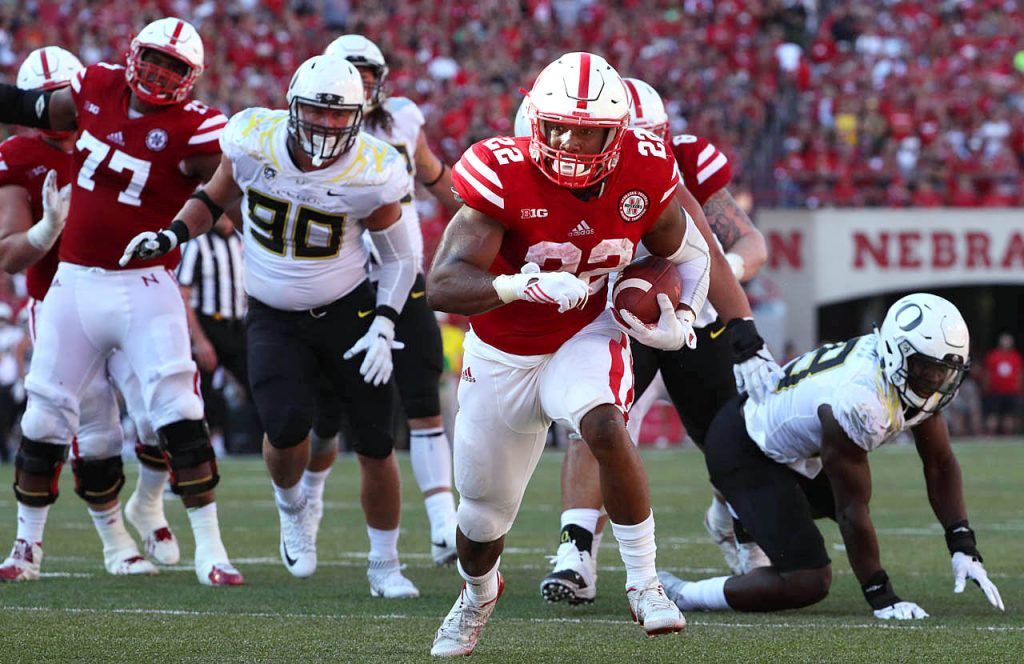 Nebraska running back Devine Ozigbo scampers into the end zone for a touchdown against Oregon at Memorial Stadium in Lincoln, Neb.