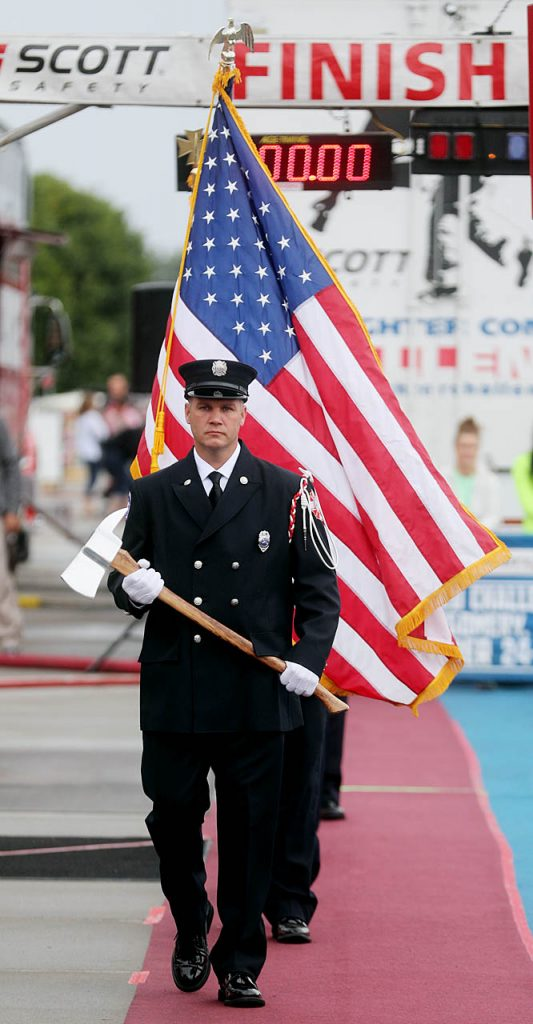 Travis Mitchell, a Grand Island firefighter leads the Honor Guard to present colors for the National Anthem during the Scott Firefighter Challenge at the 2016 Nebraska State Fair.
