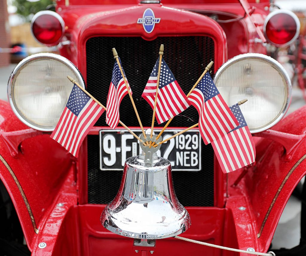 Five flags are place in the top of a fire bell on an Ellsburg Fire Dept. 1930 fire pump at the 2016 Nebraska State Fair.