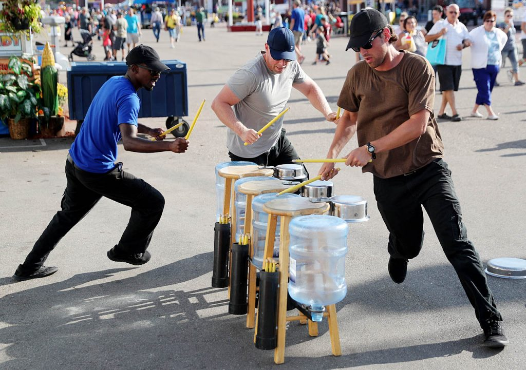 The Procrastinators from San Diego, Calif. Jamar Williams, left, Chris Doolittle, center and Warren Taylor run around their homemade drum sets while performing at the 2016 Nebraska State Fair.