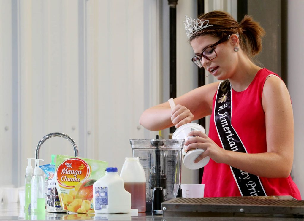 Tabitha Mansker, 2016 American Honey Princess, makes a smoothie while holding a cooking class with honey in conjunction with the American Bee Federation in the Raising Nebraska presentation kitchen Friday at the Nebraska State Fair.