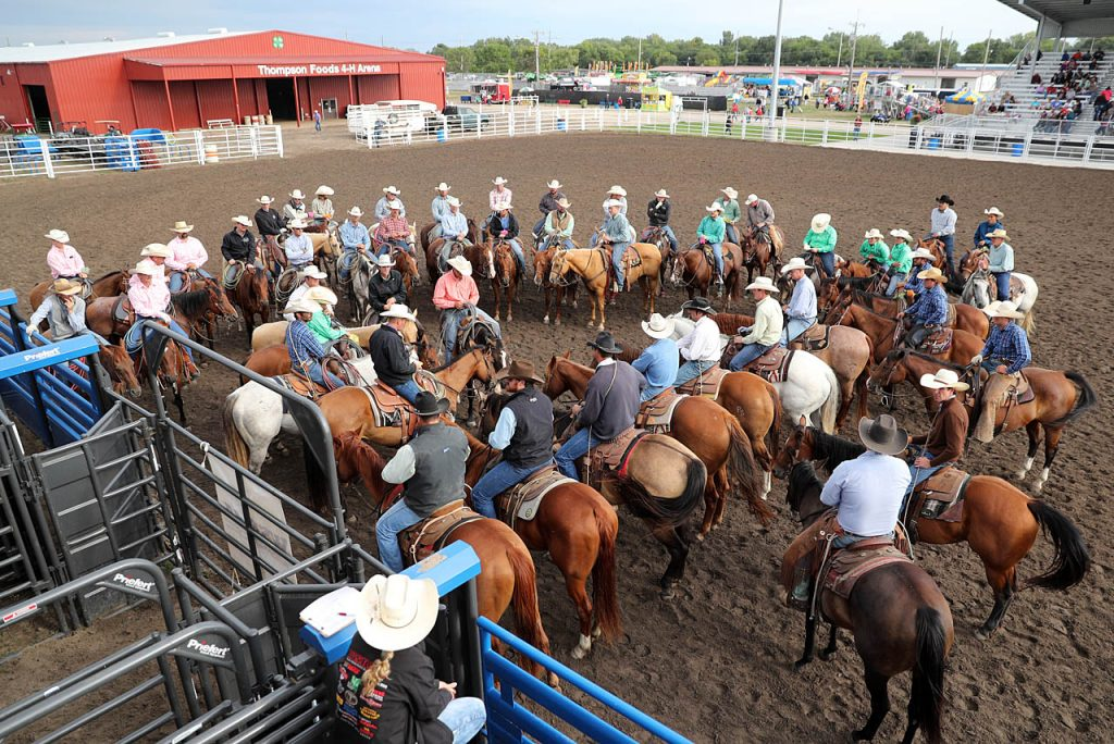 A meeting is held prior to a State Fair Ranch Rodeo sanctioned with the WSRRA in the Thompson Foods Open Air Arena.