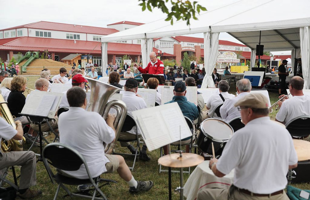 Bruce Bartels conducts the North Bend Community Band during the opening ceremony of the 2016 Nebraska State Fair.