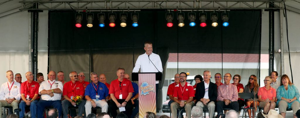 Mayor Jeremy Jensen shares a laugh while taking the podium during the 2016 Nebraska State Fair opening ceremony.