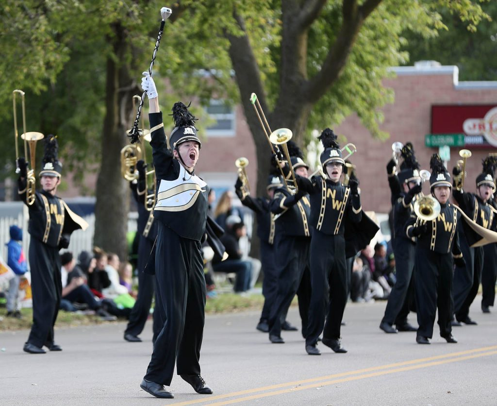 An enthusiastic drum major, Dalton Elliott of Northwest High School, leads his bandmates along the 2016 Harvest of Harmony Parade route as one of 107 bands participating in Grand Island, Neb.