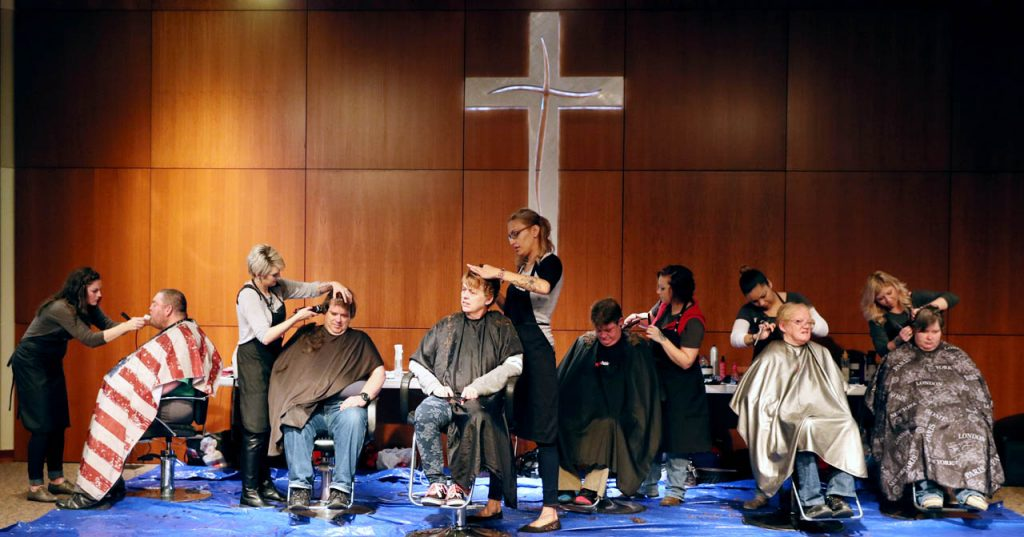 Stylists from Jeffery's Salon and Spa Kari Chavez, Dawn Westpfahl, Stephanie Roberts, Rebecca Kothe-Eckhardt, Nicole Yarns and Karina Johnston give haircuts inside the Grand Island Evangelical Free Church chapel during Project Homeless Connect.