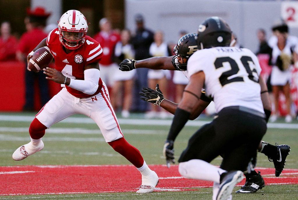Nebraska quarterback Tommy Armstrong Jr. avoids Purdue's pass rush in the fourth quarter. Nebraska won 27-14.