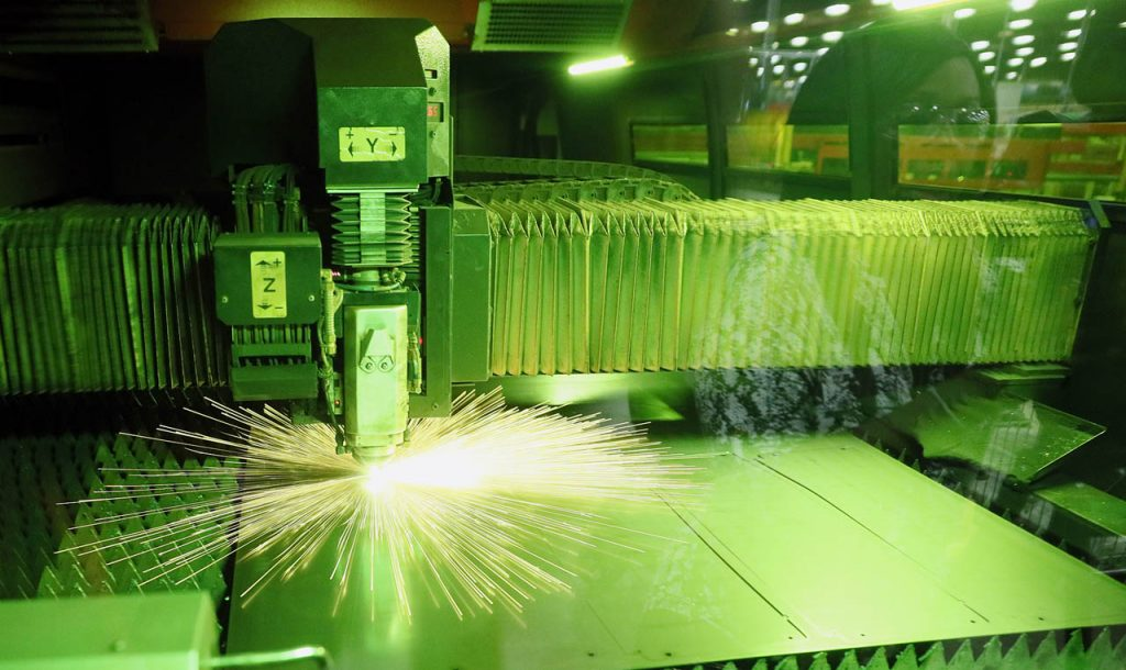 A fiber optics laser cuts through 12-gauge steel as part of an automated system inside Standard Iron Tuesday. The Grand Island Area Chamber of Commerce sponsored a tour of the 175-employee plant for National Manufacturing Month. (Independent/Andrew Carpenean)