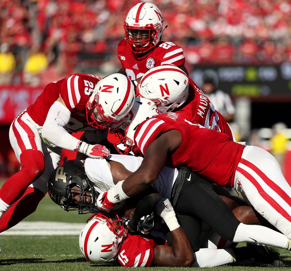 Nebraska players combine for a tackle of Purdue wide receiver Malik Kimbrough with linebacker Michael Rose-Ivey (15) making the first hit at Memorial Stadium in Lincoln.