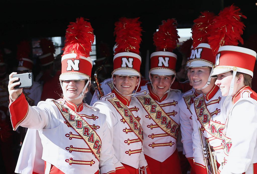 Nebraska Marching Band members take a selfie in the huskers tunnel before taking the field at Memorial Stadium in Lincoln.