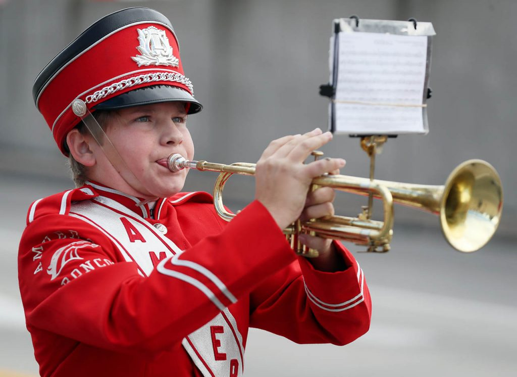 An Amherst Broncos trumpet player reads his sheet music while performing in the 2016 Harvest of Harmony Parade.