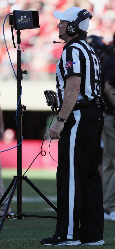 Big 10 referee Jerry McGinn reviews a play during the Nebraska vs. Purdue NCAA football game at Memorial Stadium in Lincoln.