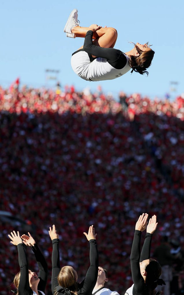 A cheerleader flips in the air as the Purdue Boilermakers celebrate a touchdown against Nebraska.
