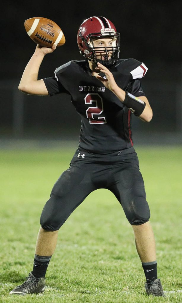 Heartland quarterback Lane Huebert throws into the flat against East Butler Wednesday night in Henderson.