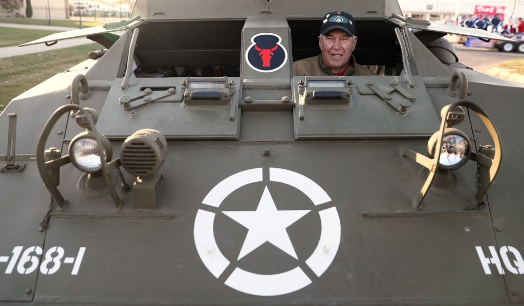 Paul Koenig, a member of the Army National Guard from 1956-64 sits inside a M20 armored utility car that he drove during the Veterans Recognition Parade in Hastings, Neb.