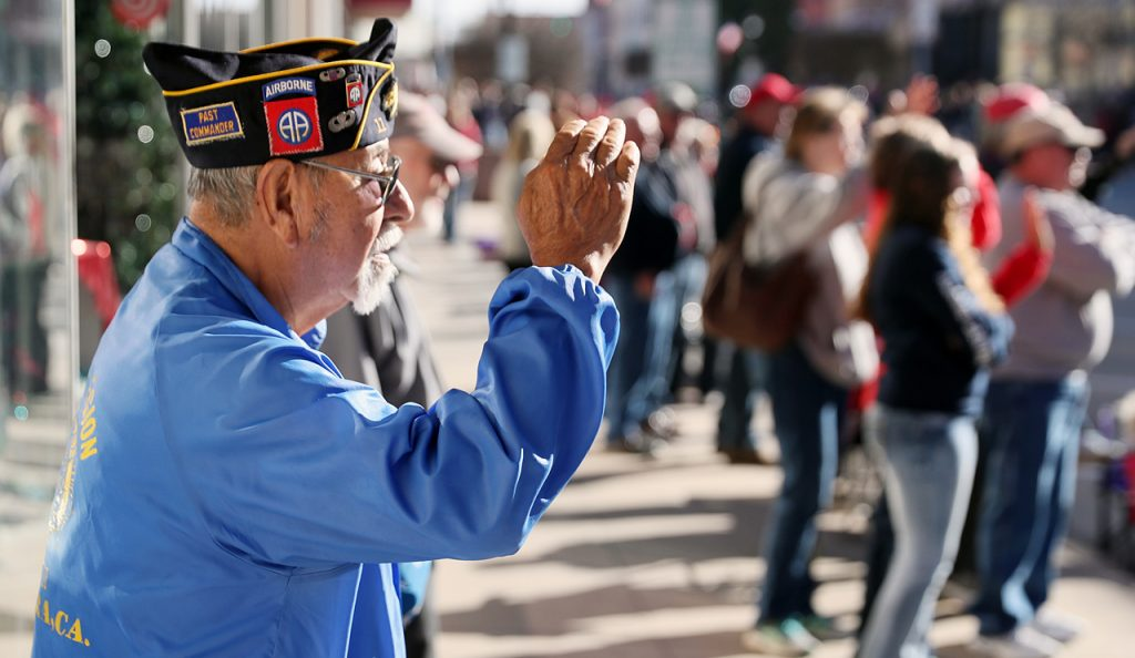 Daniel C. Alcarez salutes while watching the Veterans Recognition Parade in Hastings, Neb.