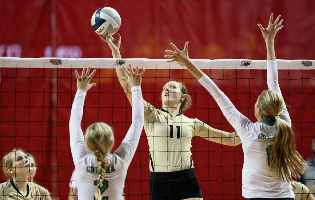 Northwest senior Kelsey Placke statically places the ball over the net against Gretna during round two of the Class B 2016 NSAA State Volleyball Championships at the Pinnacle Bank Arena.