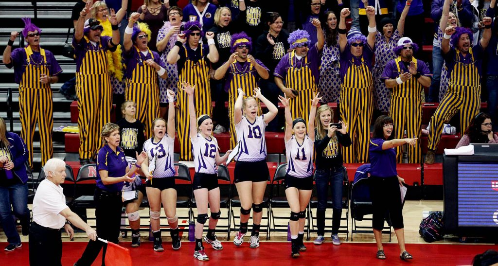 Coaches, players and some of the father's of Hampton Hawks players celebrate a point against WYNOT during the Class D2 2016 NSAA State Volleyball Championship at the Devaney Sports Center.